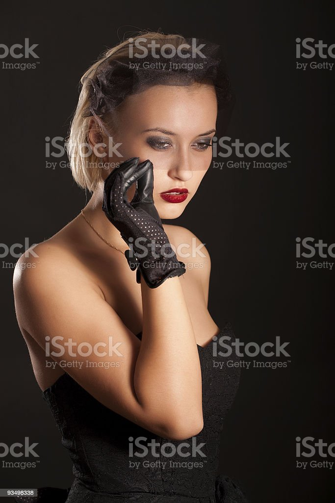 Portrait of attractive retro-style woman in black dress and veil royalty-free stock photo