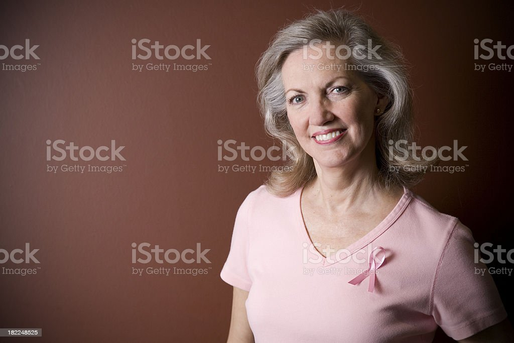Portrait of Attractive Senior Adult with Breast Cancer Ribbon royalty-free stock photo