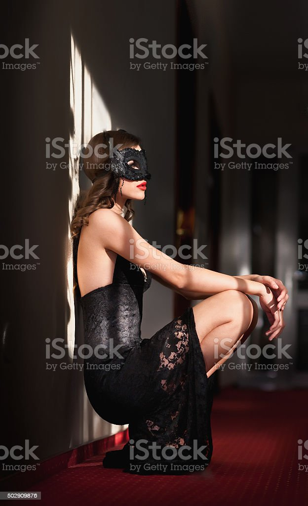 Portrait of attractive sensual young woman with mask stock photo