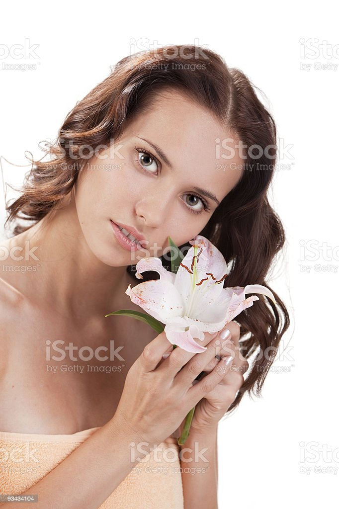 Portrait of attractive woman with white lily. stock photo