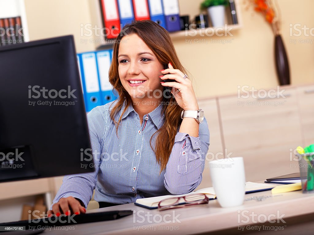 Portrait of attractive woman working in office stock photo