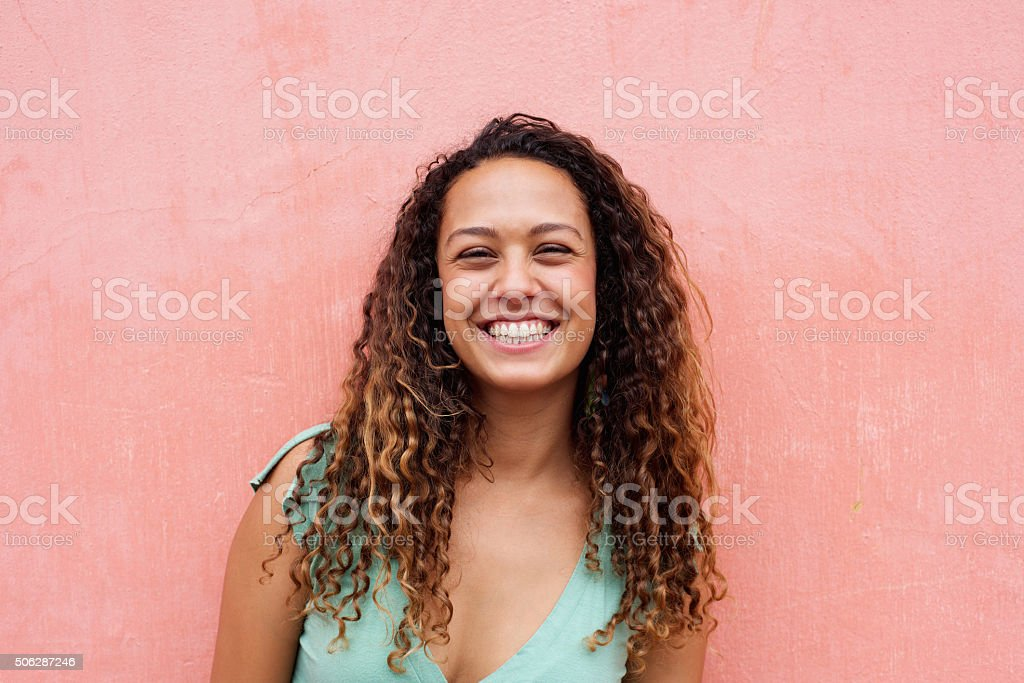 Portrait of attractive young female model smiling stock photo