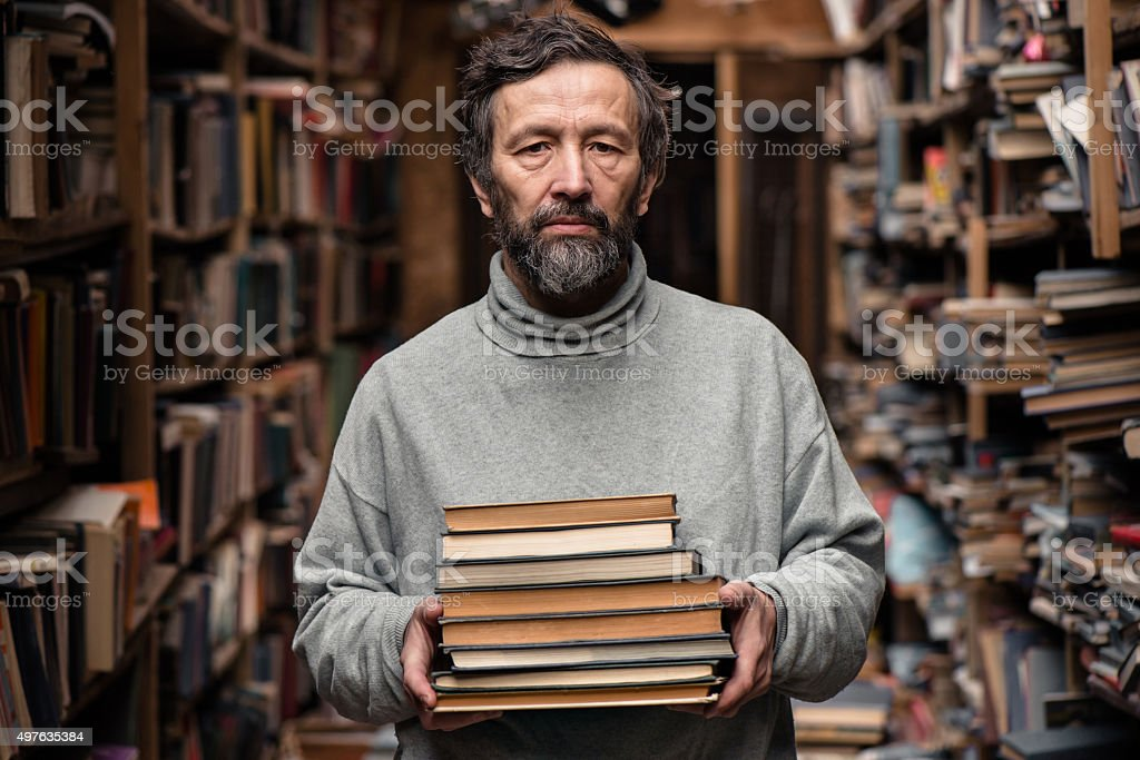 Portrait of authentic old man with beard and good eyes stock photo