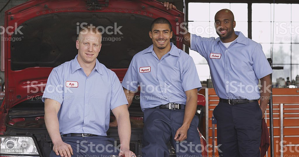 Portrait of auto mechanics in shop stock photo