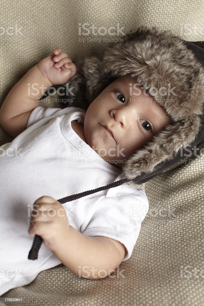 portrait of baby boy wearing a pilot hat royalty-free stock photo
