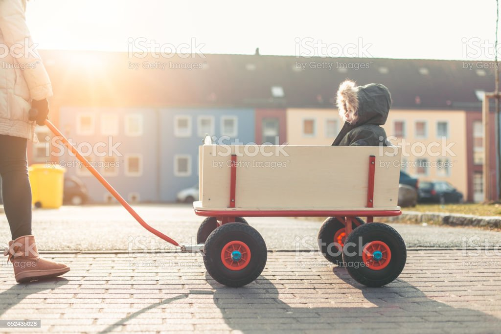 Portrait of baby driving in a big foot wagon stock photo