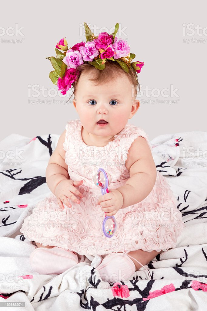 Portrait of baby with a rattle on the blanket stock photo
