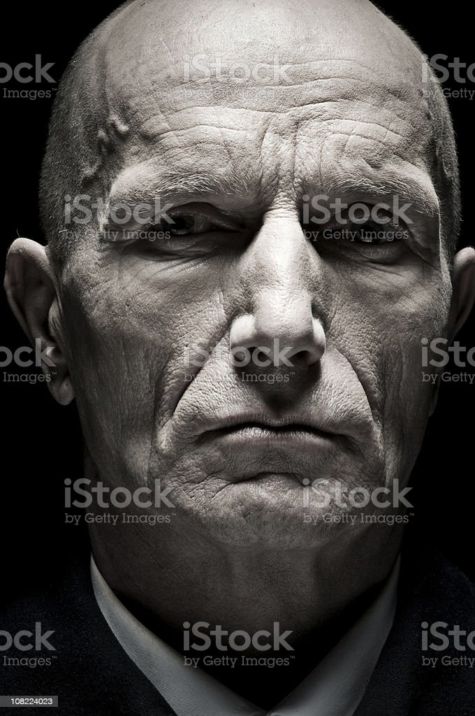 Portrait of Balding Senior Man, Low Key Toned stock photo