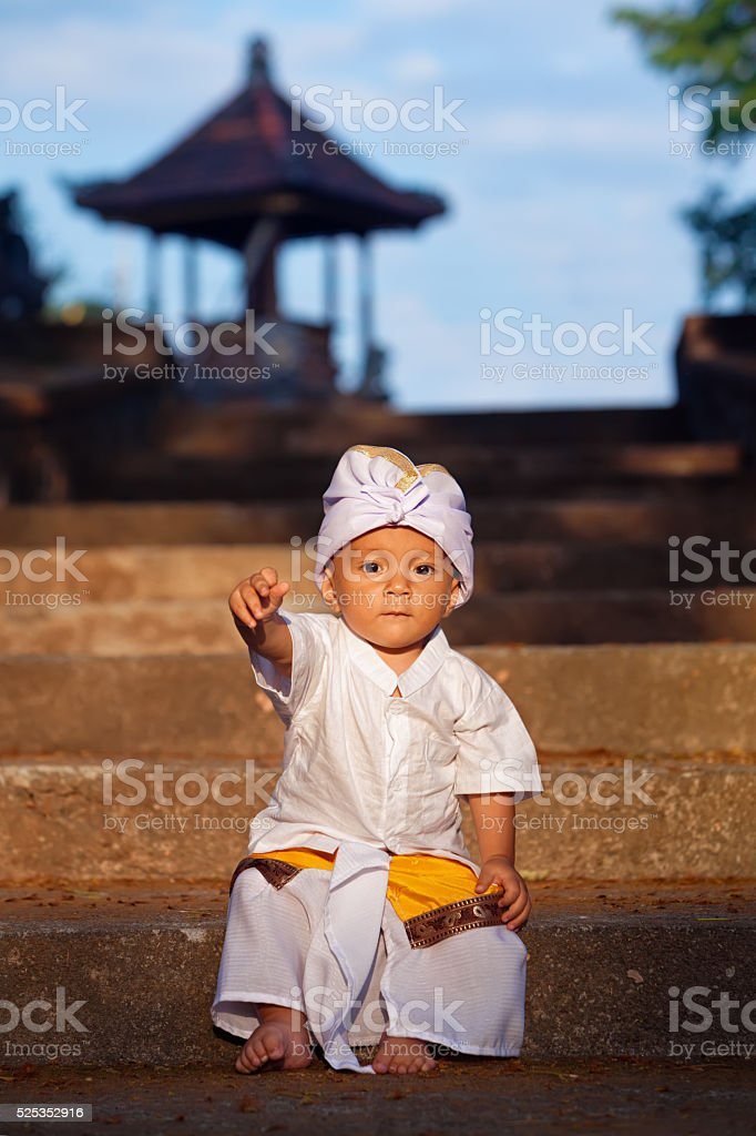 Portrait of balinese child in traditional costume - Sarong stock photo