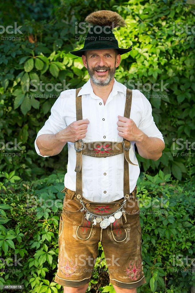 portrait of bavarian man in lederhosen stock photo