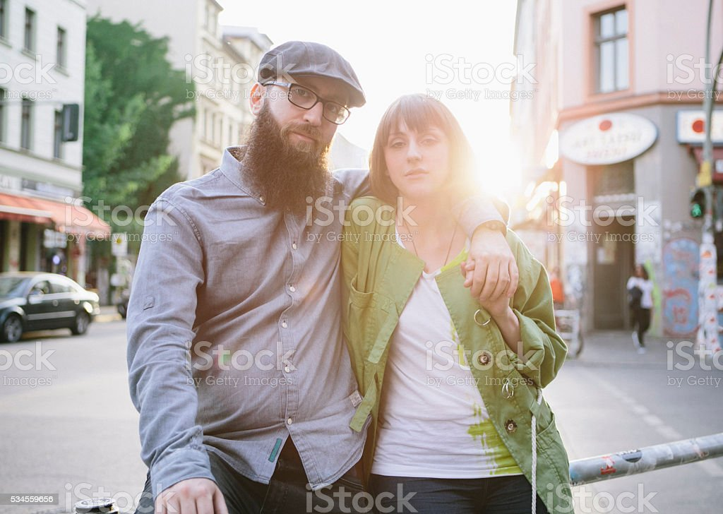 portrait of bearded hipster and girlfriend on urban background stock photo