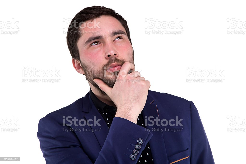 Portrait of bearded thoughtful man in blue jacket stock photo