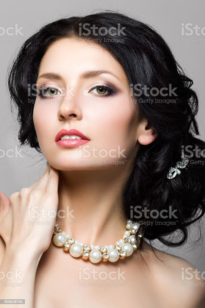 Portrait of beautiful aristocratic woman touching her neck stock photo