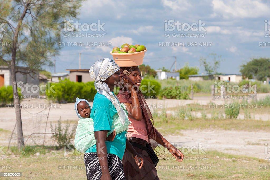 Portrait of beautiful black African women walking, Botswana stock photo
