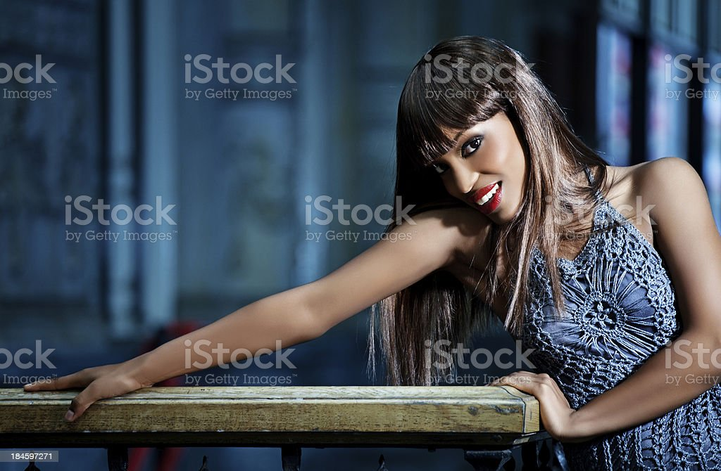 portrait of beautiful black model posing outdoors stock photo