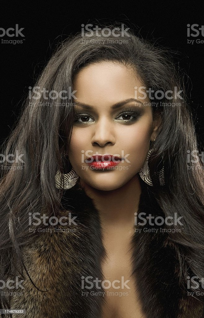 portrait of beautiful black woman with fur coat royalty-free stock photo