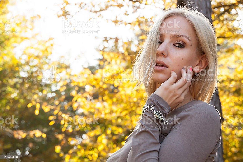Portrait of beautiful blonde in autumn stock photo