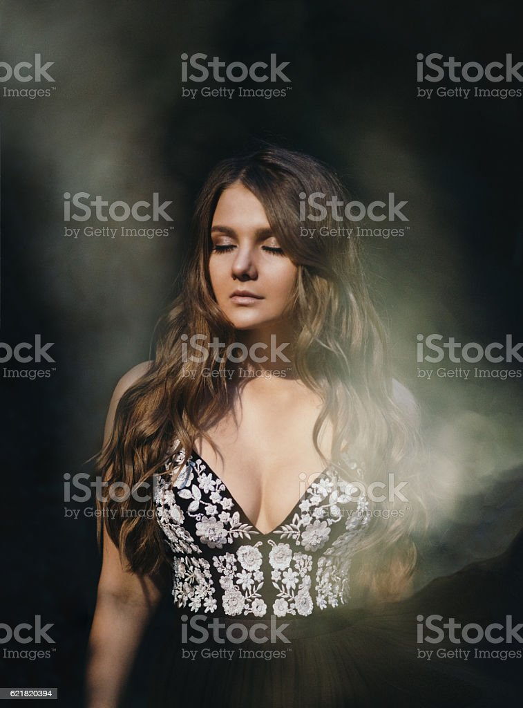 Portrait of beautiful brunette  with closed eyes and dust stock photo