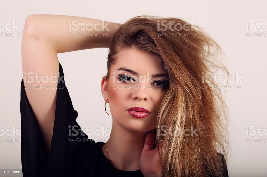 Portrait of beautiful brunette woman in black dress. Fashion pho royalty-free stock photo