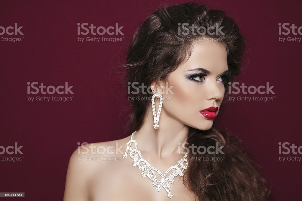Portrait of beautiful brunette woman with diamond jewelry. royalty-free stock photo