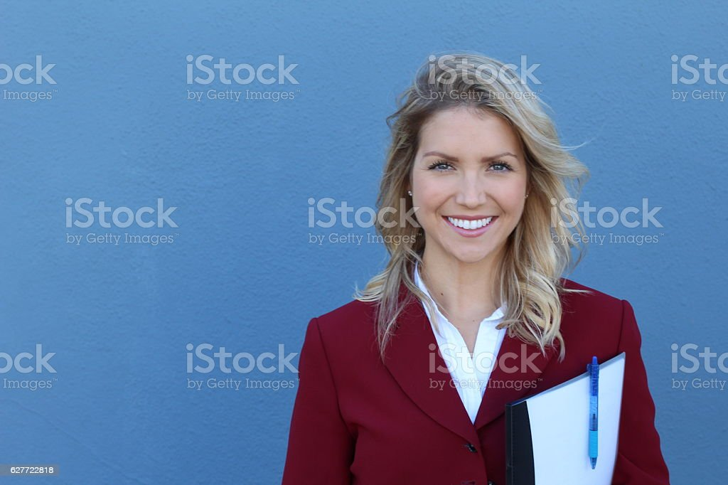 Portrait of beautiful businesswoman holding documents stock photo