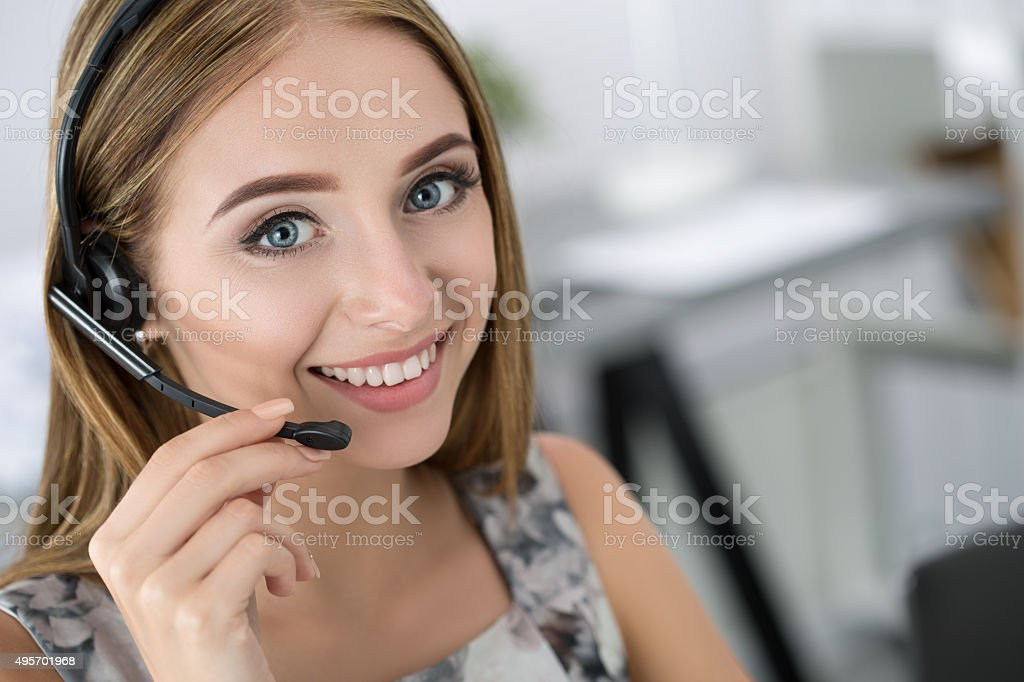 Portrait of beautiful call center operator at work stock photo