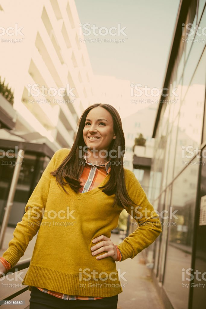 Portrait of beautiful cheerful young woman in casual clothing stock photo