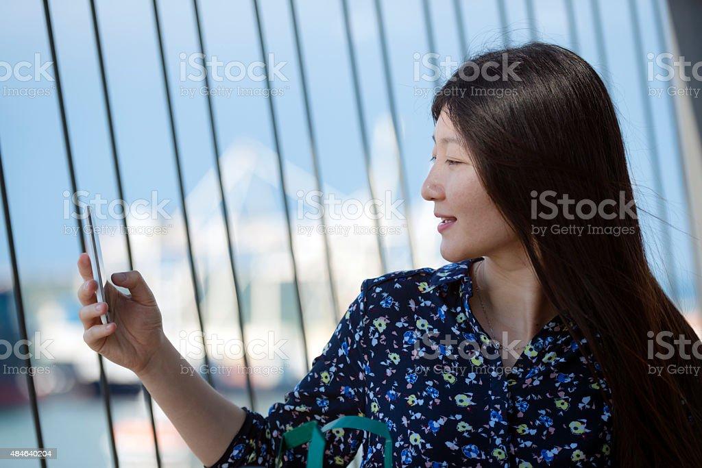 Portrait of Beautiful Chinese Woman Photographing Koper, Slovenia, Europe stock photo