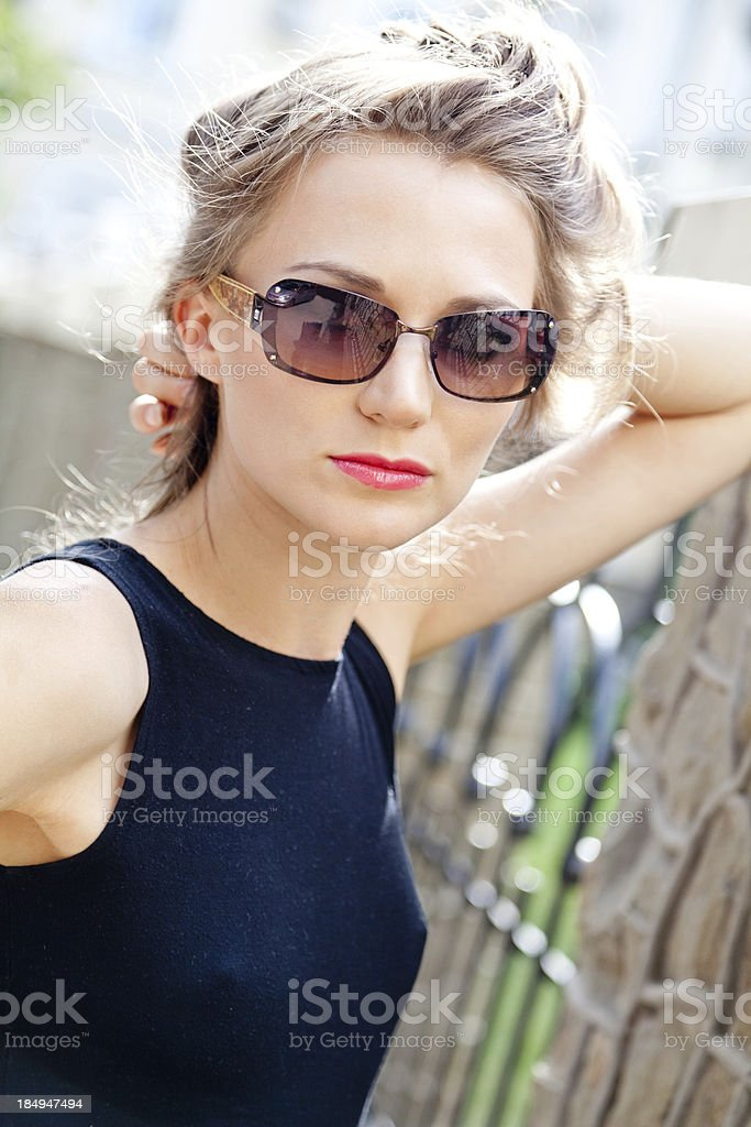 Portrait of  beautiful confident young woman in sunglasses outdoors royalty-free stock photo