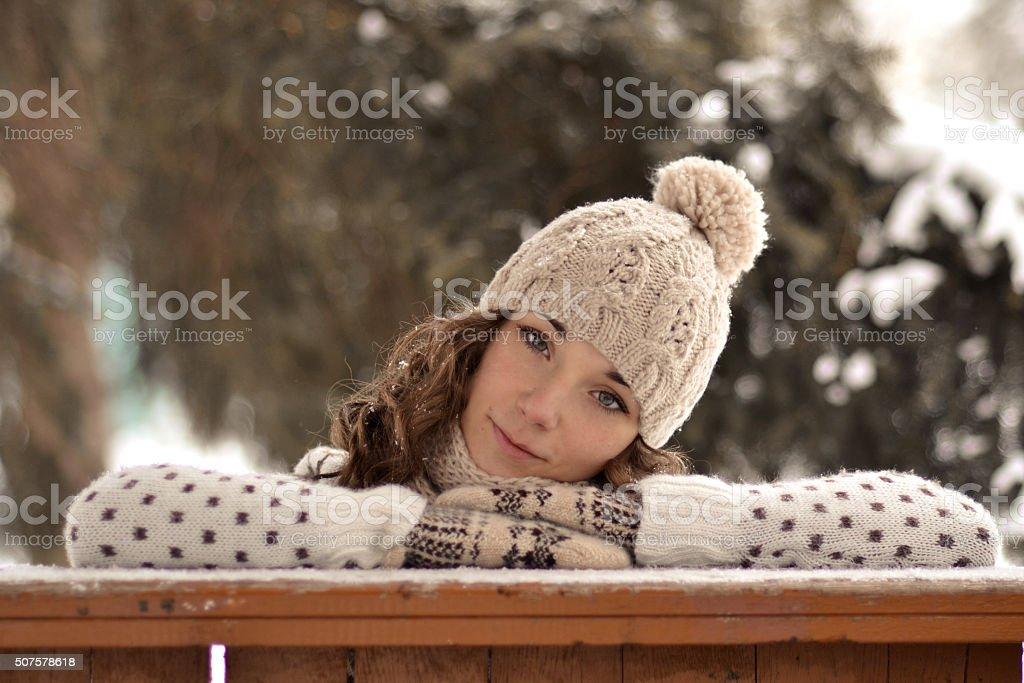 Portrait of beautiful, cute girl in winter hat, winter forest stock photo