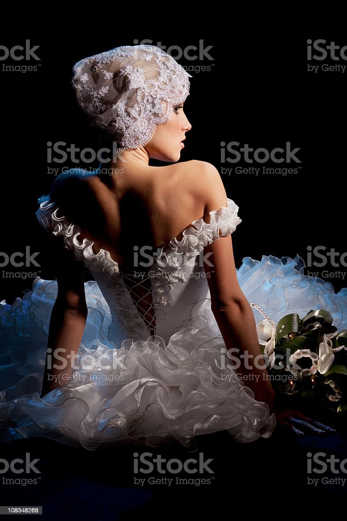 Portrait of Beautiful Elegant Bride Sitting  with Bouquet. royalty-free stock photo