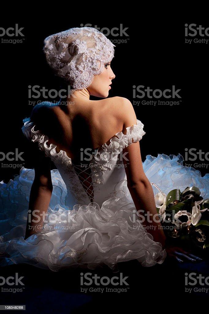 Portrait of Beautiful Elegant Bride Sitting  with Bouquet. stock photo