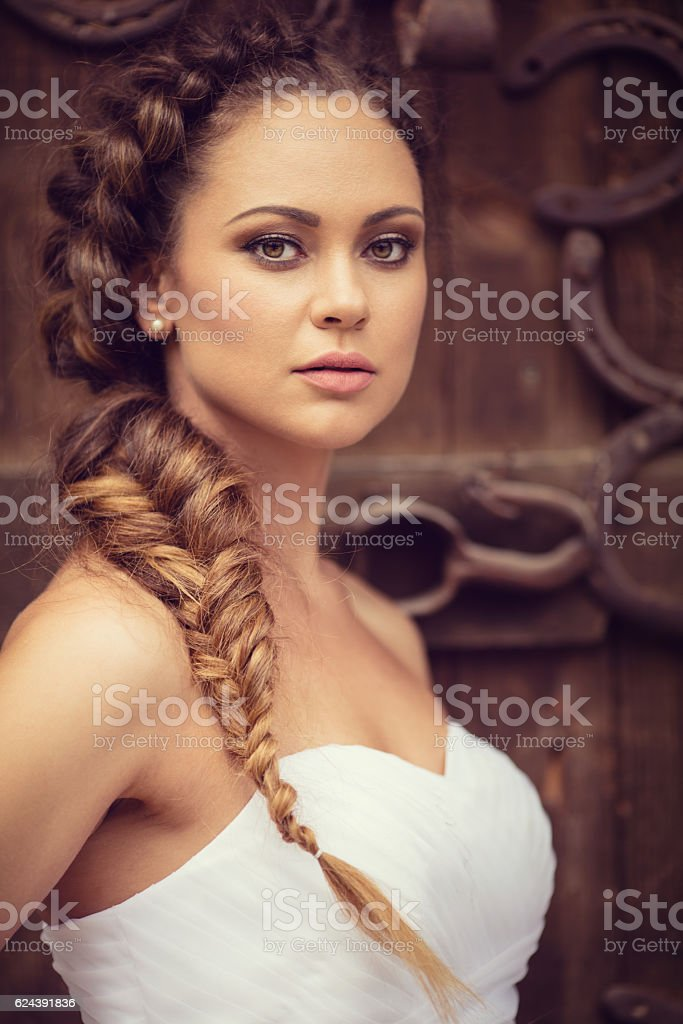 Portrait of beautiful fashion model as a bride posing outdoors stock photo