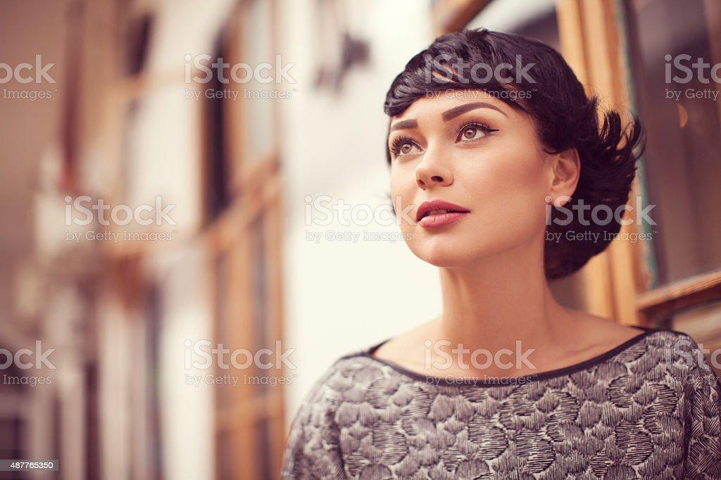 Portrait of beautiful fashion model posing outdoors stock photo