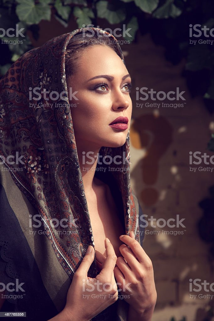 Portrait of beautiful fashion model posing outdoors stock photo