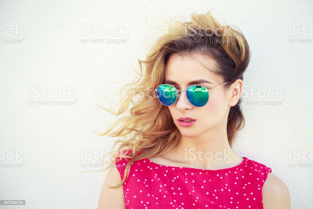 Portrait of Beautiful Fashion Woman in Sunglasses stock photo
