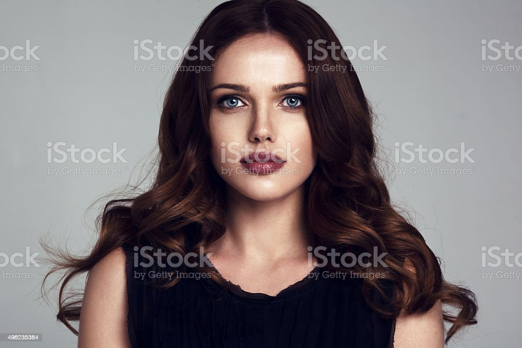 Portrait of beautiful female model on gray background stock photo