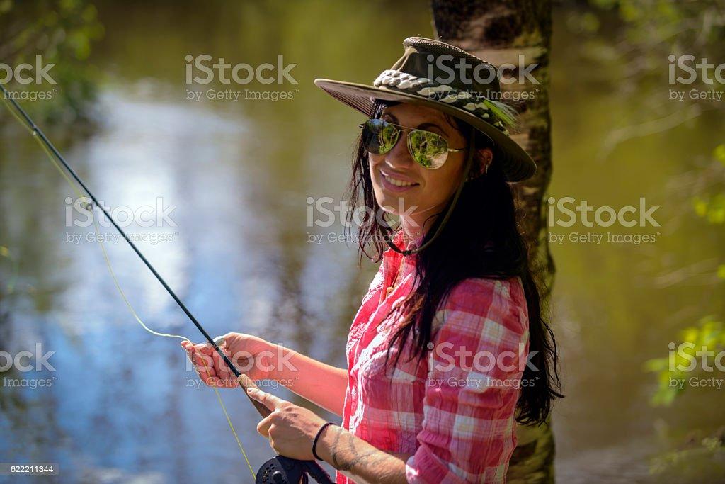 Portrait of Beautiful Fishing Woman stock photo