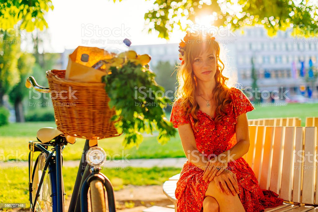 Portrait of beautiful ginger girl with bicycle stock photo