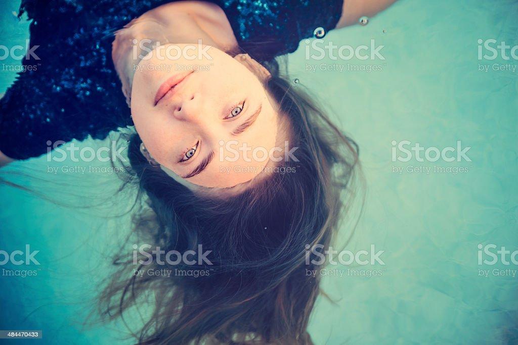Portrait of beautiful girl in water. stock photo