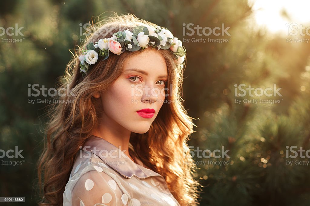 portrait of beautiful girl in wreath, free space stock photo