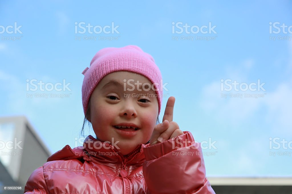 Portrait of beautiful girl on background of the blue sky stock photo