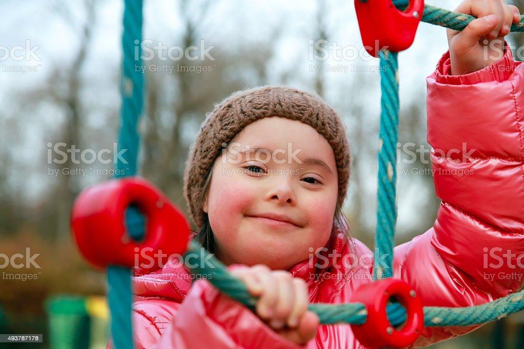 Portrait of beautiful girl on playground stock photo