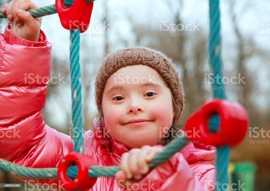 Portrait of beautiful girl on the playground stock photo