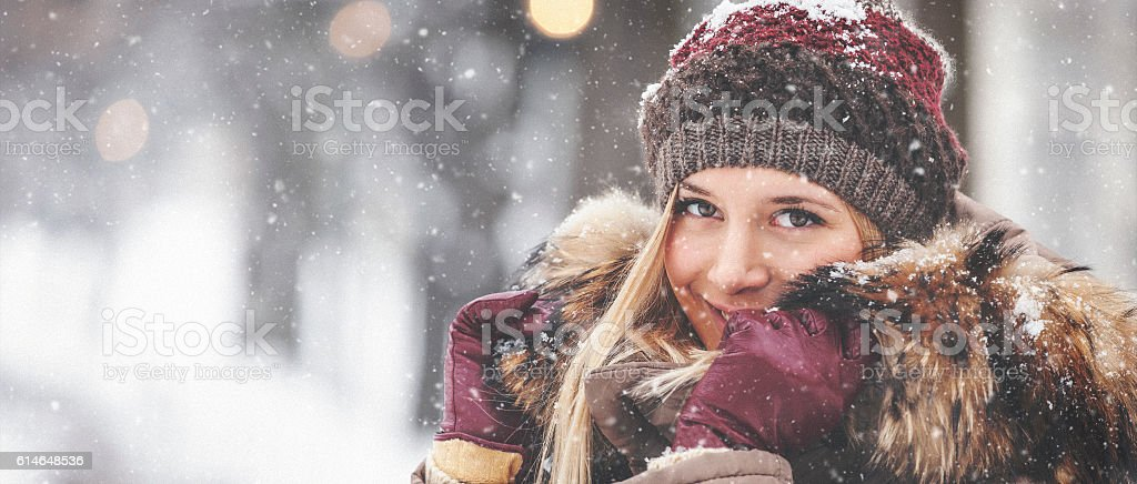 Portrait of beautiful girl outdoors while showing stock photo