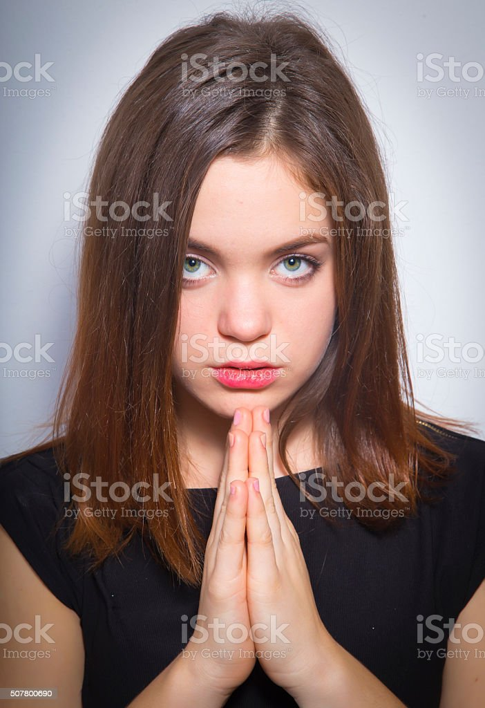 Portrait of beautiful girl praying royalty-free stock photo