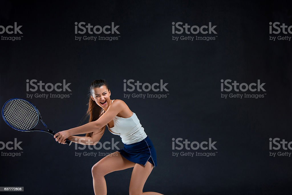 Portrait of beautiful girl tennis player with a racket on stock photo