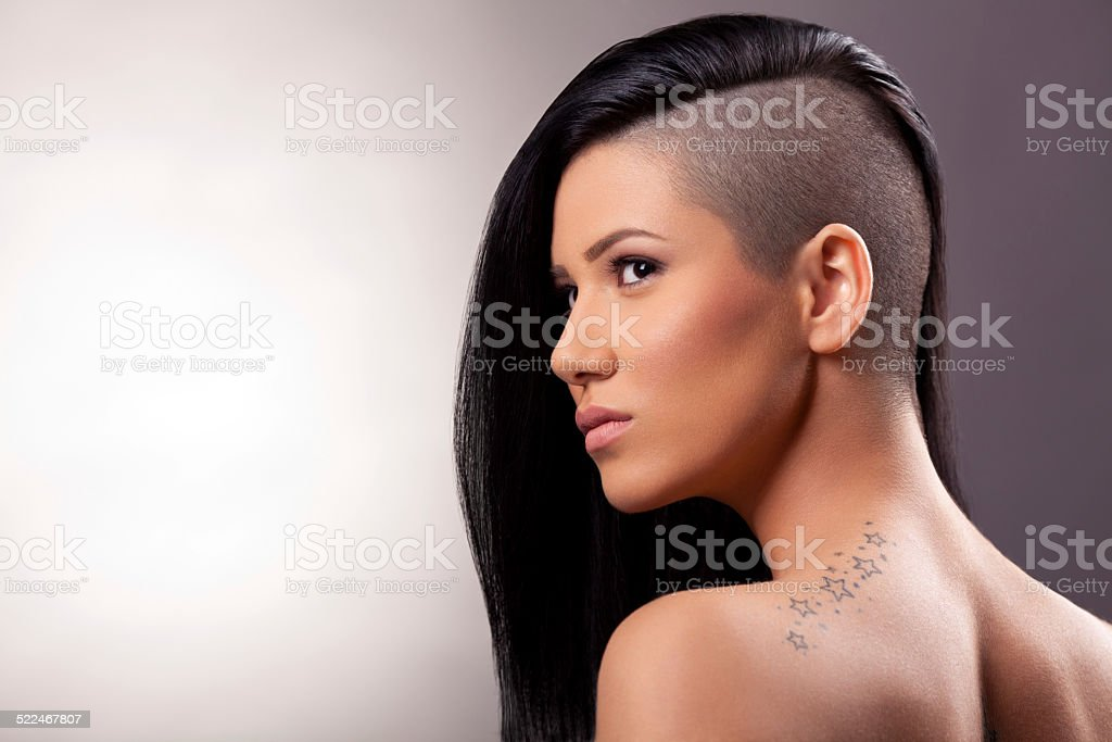 Portrait of  beautiful girl with a Mohawk hairstyle stock photo