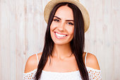 Portrait of beautiful girl with beaming smile in summer hat