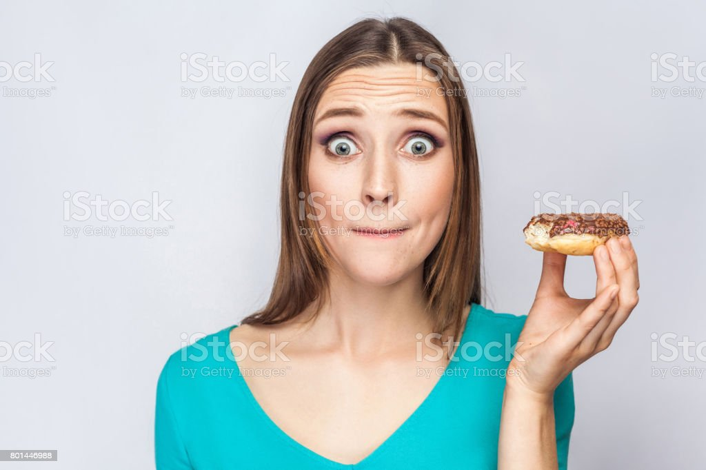 Portrait of beautiful girl with chocolate donuts. stock photo